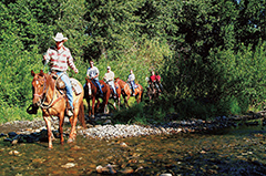 Horseback riders by a creek at Sun Valley, Idaho