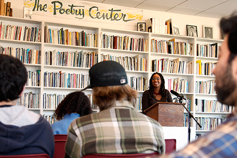 Photo of students listening to a lecturer in the Poetry Center at SF State